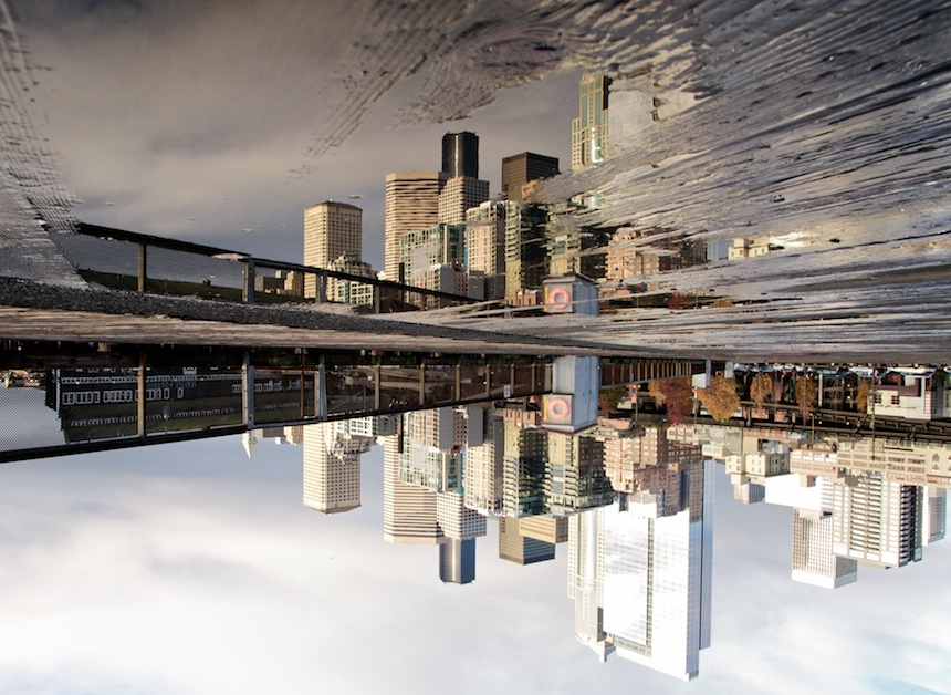 Seattle Skyline reflected in puddle